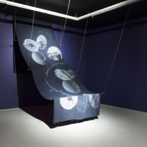 Kathy Robins. Fabric of the Universe. 2018. Fabric. 100 x 10 cm. Installation view.