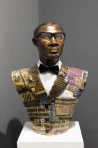 Maurice Mbikayi and Nicola Holgate. Two Rises and Falls (Lumumba). 2019. Papier maché and mixed media bust. 71 x 42 x 21 cm. Installation view.