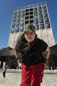 A portrait of the artist Tracey Rose in front of the Zeitz MOCAA